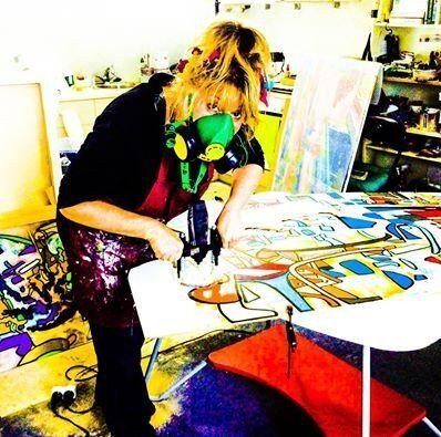 Rachel Rovay in her Studio with Router